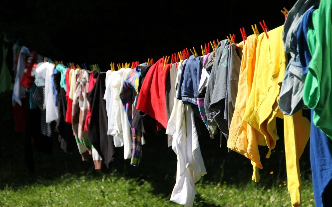 collapsible laundry basket clothes hanging outside on line to dry