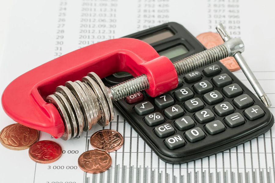 calculator c clamp and coins