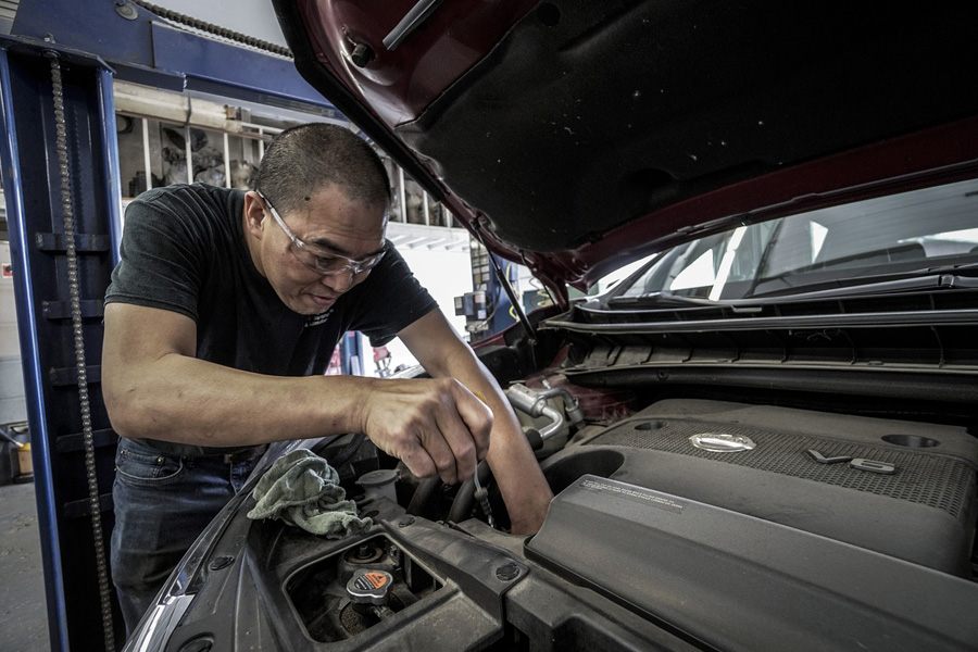 man repairing the engine