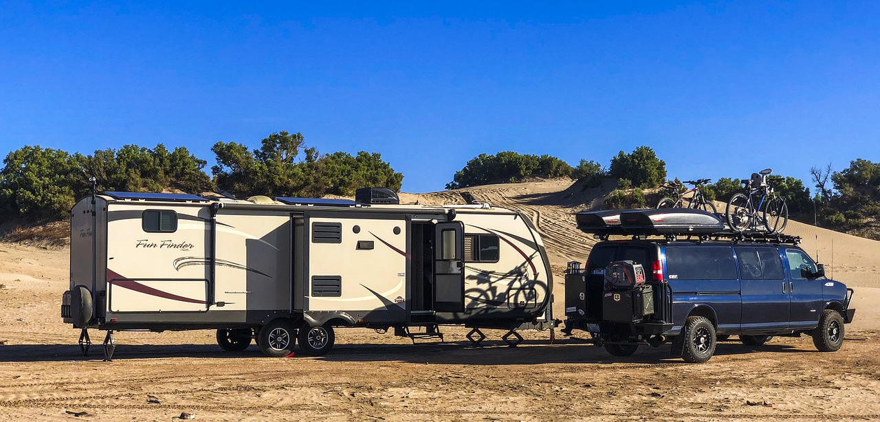travel trailer with vehicle on Mexican beach