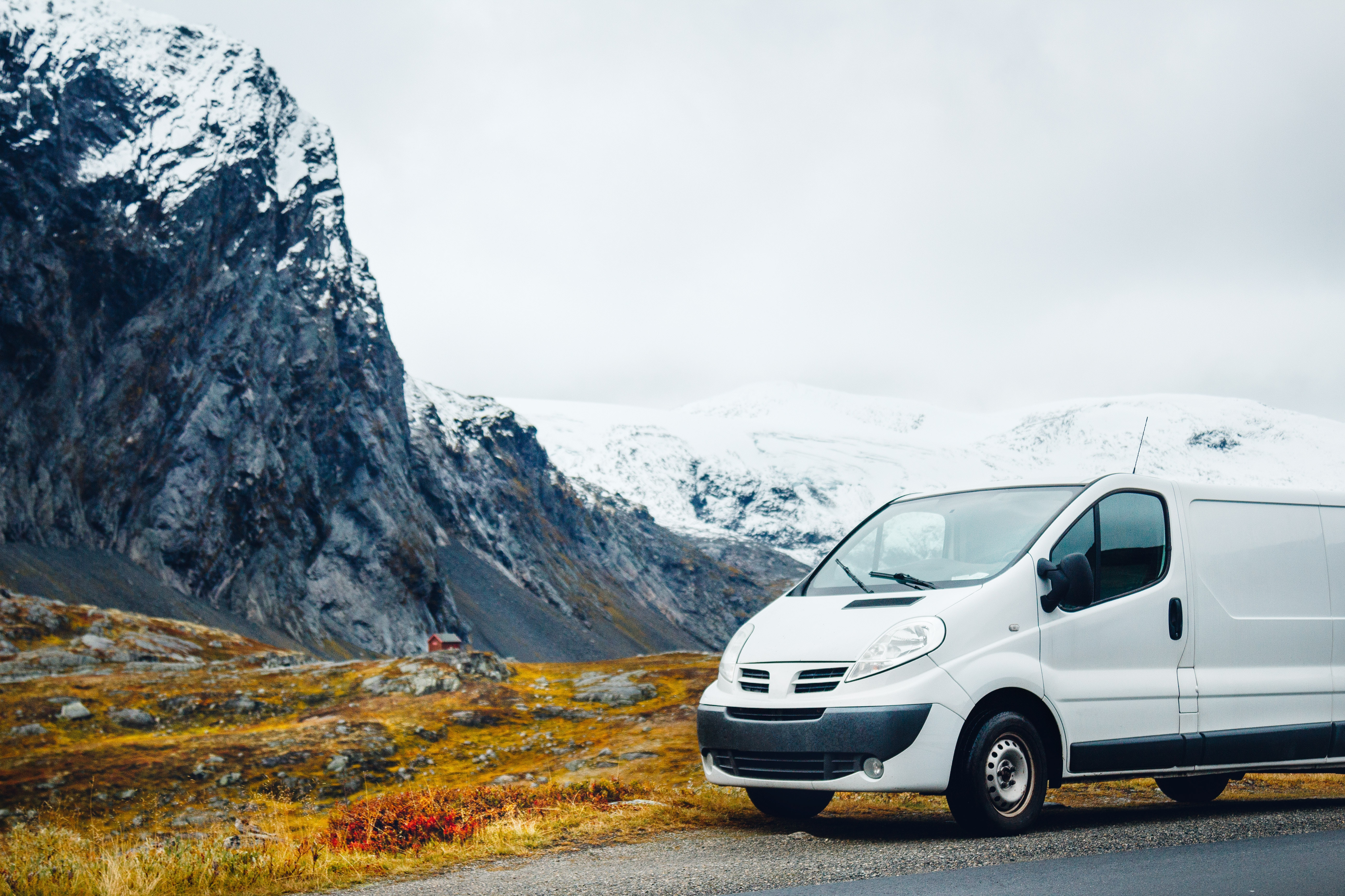 white camper van parked near a mountain