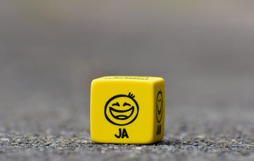 a dice with a smiley