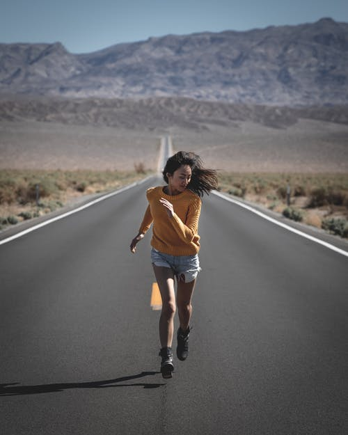 Outdoor world: Woman running on the road
