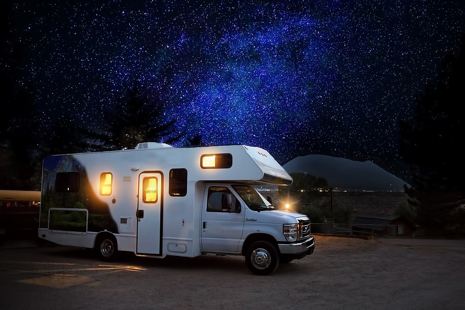 White RV with stars background