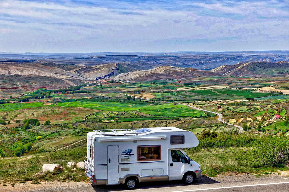 an RV parked along the road overlooking a great view